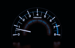 Image showing a digital speedometer to show that page loading speed is very important and a slow page load speed will be costing you a lot of money