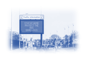 Image showing a road sign that says: Stay at home protect the NHS save lives